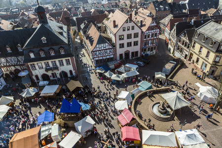 12th century: GELNHAUSEN, GERMANY - MARCH 9. people enjoy the 24th Barbarossamarkt festival on March 9, 2014 in Gelnhausen, Germany. The annual event lasts 4 days and takes place all over the city.