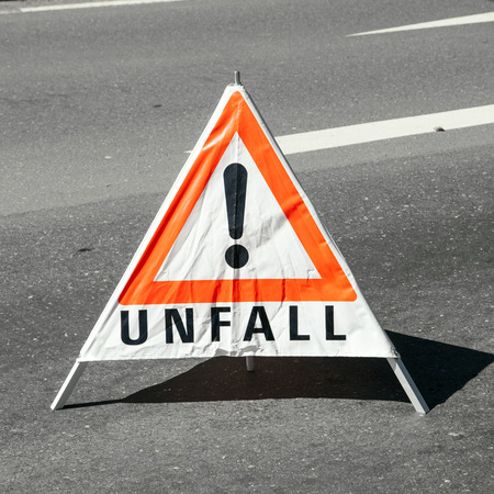 accident warning sign at the street for other cars photo