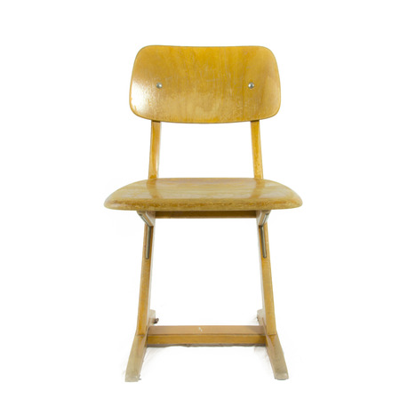 old german used wooden school chair for the young pupils photo