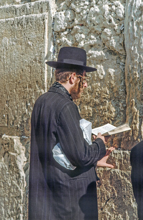 annexation: JERUSALEM - JANUARY 1:- Orthodox jewish man prays at the Western Wall on Jan 1, 1994 in Jerusalem, Israel. Israels annexation of East Jerusalem in 1967, including the Old City, was never internationally recognized.