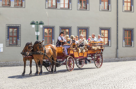 inclined: ERFURT, GERMANY - MAY 27: romantically inclined visitor enjoy the special historical  horse-drawn coach to see the city on May 27, 2012 in Erfurt, Germany. Editorial