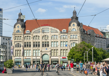 financed: ERFURT, GERMANY - MAY 26: people at shopping gallery anger 1 on May 26, 2012 in Erfurt, Germany.  Anger1 was build 1906 by architect Albert and Ernst Giese and financed by Jewish family Tietz. Editorial