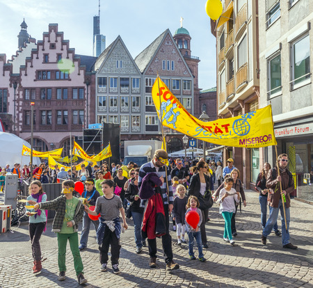 FRANKFURT, GERMANY - MARCH 29:  children at their first communion call for solidarity with all children in the world on March 29, 2014 in Frankfurt, Germany. They collect money for Misereor and have a celebration at the dome with Johannes zu Eltz.