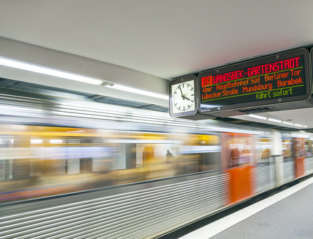 HAMBURG, GERMANY - SEP 3: people in the station with train in motion at September 3, 2012 in Hamburg, Germany.  The metro was opened in  1912 and comprises four lines serving 91 stations.