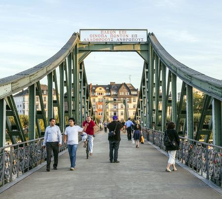 sachsenhausen: FRANKFURT, GERMANY - FEB 11: people at Eiserner steg on February 11, 2012 in Frankfurt, Germany. The Eiserner Steg is a pedestrian bridge in Frankfurt am Main built in 1868.