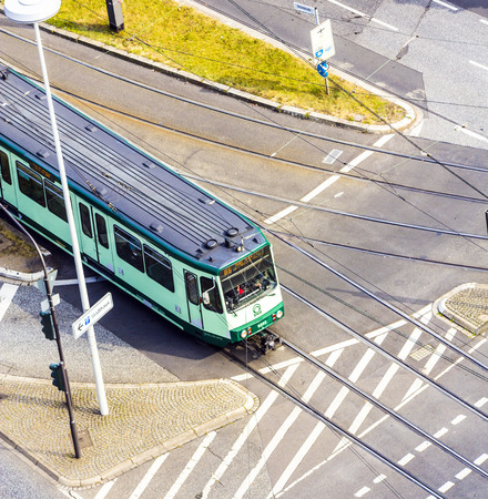 streetcar: BONN, GERMANY - SEP 21: streetcar crossing the street  on September 21, 2012 in Bonn, Germany. There are tree Streetcar lines operating today in Bonn.