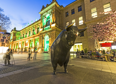 FRANKFURT, GERMANY - APRIL 4: Illuminated stock exchange with bull and bear at night on April 4, 2014 in Frankfurt, Germany. This festival Luminale takes place in Frankfurt every 2 years and lasts one week.