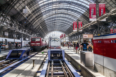 frequented: FRANKFURT, GERMANY - AUGUST 11: Inside the Frankfurt central station on Aug 11, 2012 in Frankfurt, Germany. With about 350.000 passengers per day its the most frequented railway station in Germany.