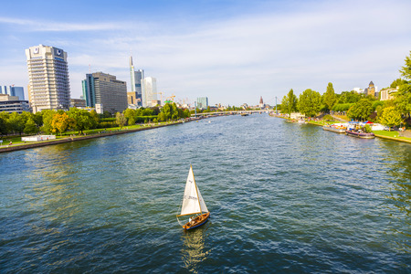 FRANKFURT, GERMANY - AUG 31: view to river main with boat and skyline at Aug 31, 2008 in Frankfurt, Germany. The Main river with a length of 527 km is the most significant right tributary of the Rhine.