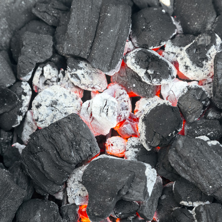 burning hot charcoal in the background with flame photo