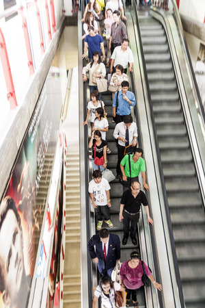 BANGKOK, THAILAND - MAY 6: people on a moving staircase on May 12, 2009 in Bangkok, Thailand.  The city occupies 1,568.7 square kilometres and has a üopulation of more than 6 Mio people.