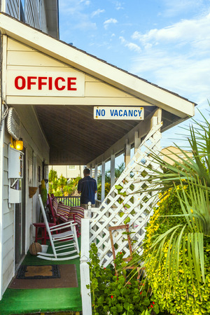 outerbanks: motel in the outer banks, USA with no vacancy sign