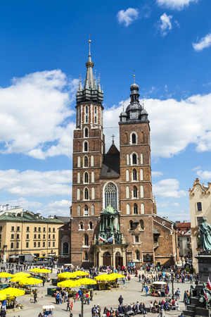 KRAKOW, POLAND - MAY 5, 2014: Tourists at the Market Square in Krakow . Main Market Square, one of the largest medieval squares in Europe, was built in 1257.