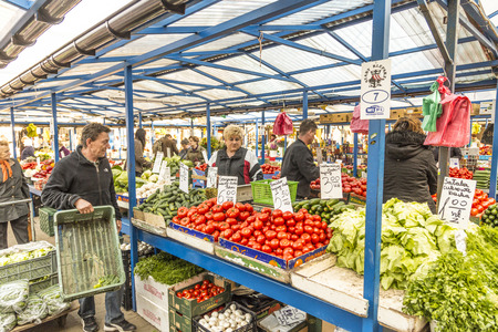 stary: KRAKOW, POLAND - MAY 5, 2014: people sell their goods at the market Stary Kleparz on May 5, 2014 in Krakow, Poland. The covered marketplace has a tradition over 800 years.