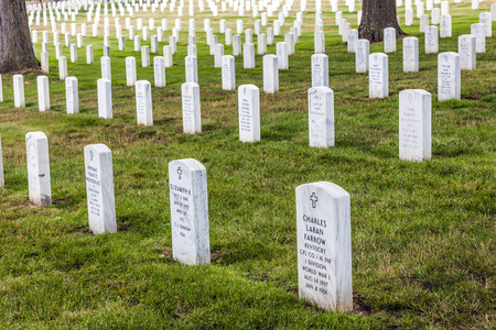 WASHINGTON DC - JUL 15: Gravestones on Arlington National Cemetery on July 15,2010 in Washington DC, USA. Headstones mark soldier graves who died in every conflict from Revolution to Sept 11.