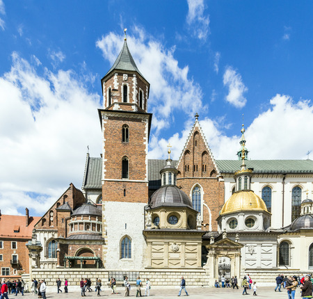 KRAKOW, POLAND - MAY 4, 2014: people visit Royal Archcathedral Basilica of Saints Stanislaus and Wenceslaus on the Wawel Hill. More than 900 years old, it is the Polish national sanctuary.
