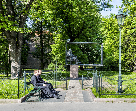 historical events: KRAKOW, POLAND - MAY 4: people sittin at monument for Jan Mateyko on May 4, 2013 in Krakow, Poland. He was a Polish painter known for paintings of notable historical Polish political and military events.