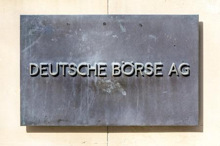 frankfurt stock exchange: FRANKFURT, GERMANY - MARCH 29, 2014: sign deutsche Börse AG - German stock exchange in front of Frankfurt stock exchange in Frankfurt, Germany. Frankfurt Stock exchange is the most important in Germany.