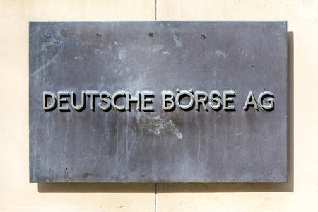 ag: FRANKFURT, GERMANY - MARCH 29, 2014: sign deutsche Börse AG - German stock exchange in front of Frankfurt stock exchange in Frankfurt, Germany. Frankfurt Stock exchange is the most important in Germany.