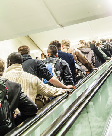 FRANKFURT, GERMANY - MAY 16, 2014: People go on the escalator in the Frankfurt Metro in Frankfurt, Germany. Frankfurt has an underground railway metropolitan transit system composed by 9 lines and 87 stations.