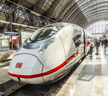 frequented: FRANKFURT, GERMANY - MAY 16, 2014: Inside the Frankfurt central station in Frankfurt, Germany. With about 350.000 passengers per day its the most frequented railway station in Germany. Editorial