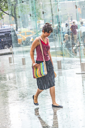NEW YORK, USA - JULY 8, 2010: women in heavy rain in New York. With 100 mm the average railfall the July is the most wet day of a year in New York.