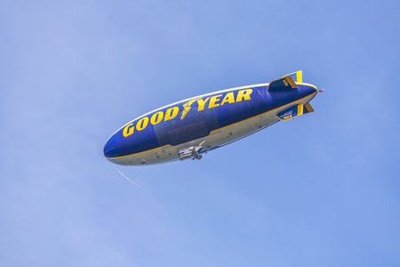 FORT LAUDERDALE, USA - AUG 1, 2010: The Good Year blimp Zeppelin, Spirit of Goodyear (with distinctive yellow stripe), flies over Fort Lauderdale, USA. Rides aboard the Goodyear Blimp are by invitation only.