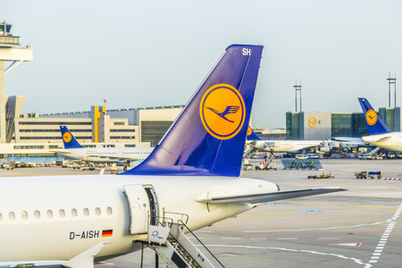 FRANKFURT, GERMANY - MAY 22, 2014: Lufthansa Aircrafts standing at the terminal 1 at Frankfurt airport. Frankfurt is one of the busiest airport in Europe and Number one in Germany.