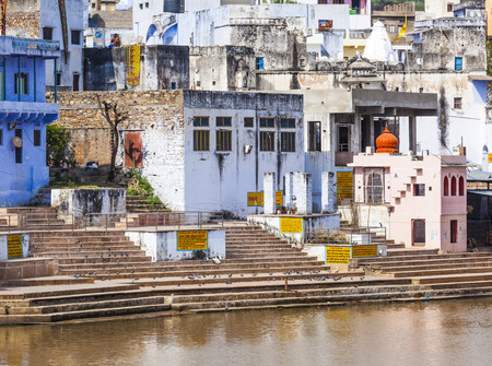 a bathing place: ritual bathing place in holy lake in Pushkar, Rajasthan, India without people