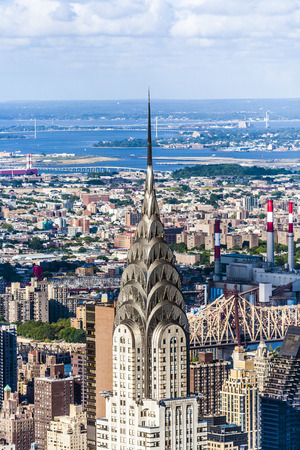 NEW YORK, USA – JULY 10, 2010: Facade of the Chrysler Building in New York, USA. At 1,046 feet the structure was the worlds tallest building for 11 months before it was surpassed by the Empire State Building in 1931.