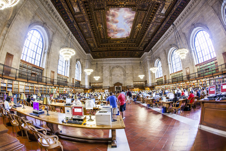 NEW YORK CITY - JULY 10, 2010: people study in the New York Public Library in Manhattan, New York, USA. New York Public Library is the third largest public library in North America.