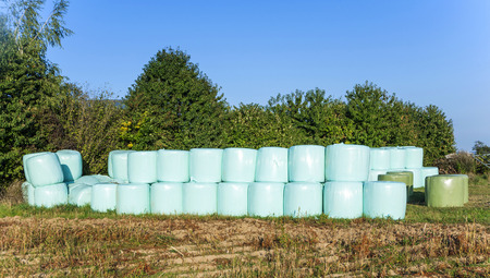 wetness: bale of straw in plastic after harvest to be protected from wetness