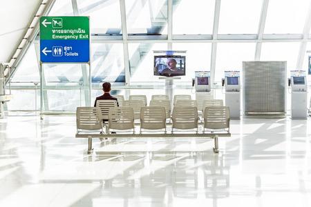 BANGKOK,THAILAND - JANUARY 5, 2010: people wait at departure terminal of Suvarnabhumi International Airport in Bangkok, Thailand. The airport is handling about 45 million passengers annually.