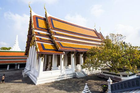 BANGKOK, THAILAND - JANUARY 4, 2010: people visit Phra Sri Ratana Chedi in the Grand palace, Bangkok, Thailand. Grand Palace is Thailands most important and sacred temple area.