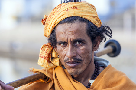 PUSHKAR, INDIA - OCTOBER 20, 2012: A Rajasthani tribal man wearing traditional colorful turban attends the annual Pushkar Cattle Fair in Pushkar, Rajasthan, India.