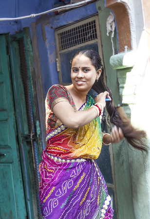 JODPUR, INDIA - OCTOBER 23, 2012: indian woman combs her hair at her home in Jodhpur, India. Jodhpur is the second largest city in the Indian state of Rajasthan with over 1 million habitants.