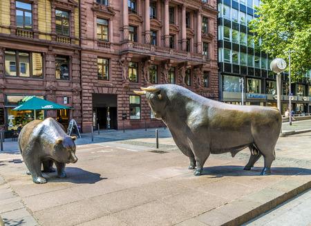 FRANKFURT, GERMANY - JUNE 3, 2014: The Bull and Bear Statues at the Frankfurt Stock Exchange in Frankfurt, Germany. Frankfurt Exchange is the 12th largest exchange by market capitalization. Publikacyjne