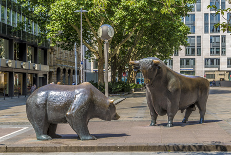 FRANKFURT, GERMANY - JUNE 3, 2014: The Bull and Bear Statues at the Frankfurt Stock Exchange in Frankfurt, Germany. Frankfurt Exchange is the 12th largest exchange by market capitalization. 報道画像