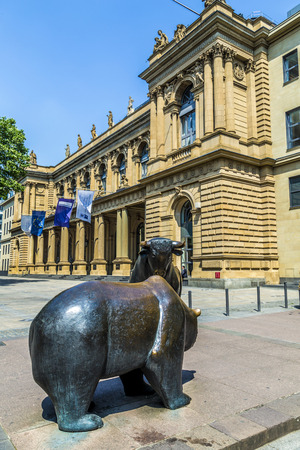 frankfurt stock exchange: FRANKFURT, GERMANY - JUNE 3, 2014: The Bull and Bear Statues at the Frankfurt Stock Exchange in Frankfurt, Germany. Frankfurt Exchange is the 12th largest exchange by market capitalization. Editorial