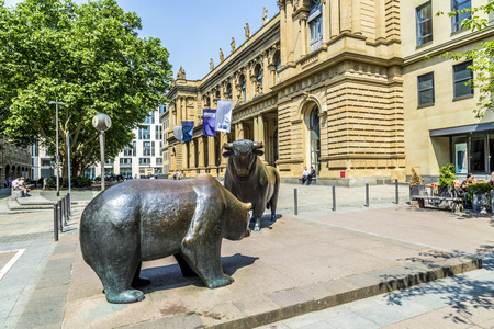 FRANKFURT, GERMANY - JUNE 3, 2014: The Bull and Bear Statues at the Frankfurt Stock Exchange in Frankfurt, Germany. Frankfurt Exchange is the 12th largest exchange by market capitalization.