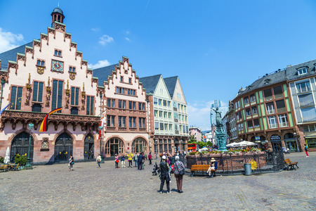 roemerberg: FRANKFURT, GERMANY - JUNE 3, 2014: People on Roemerberg square in Frankfurt, Germany. Frankfurt is the fifth-largest city in Germany, with a population of 687,775.