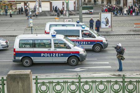 governement: VIENNA, AUSTRIA - NOVEMBER 27, 2010: police and photographer at the top of the peaceful demonstration against cutting of social spenditures by the governement specially for kids and families in Vienna, Austria. Editorial