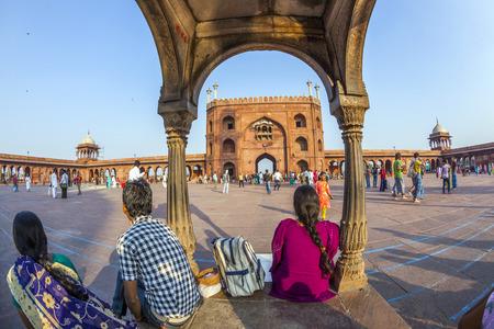 jama mashid: DELHI, INDIA - NOVEMBER 8, 2011: group of worshipers rest on the courtyard of Jama Masjid Mosque in Delhi, India. Jama Masjid is the principal mosque of Old Delhi in India.