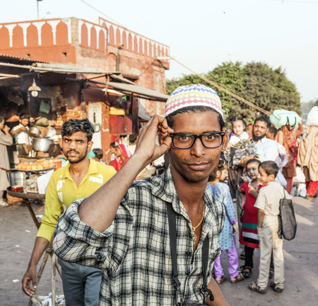 jama mashid: DELHI - NOV 8, 2011: portrait of young man with modern glasses at the Meena Bazaar Market in Delhi, India. Shah Jahan founded the bazaar in the 17th century inspired by the architecture of the Isfahan Bazaar. Editorial