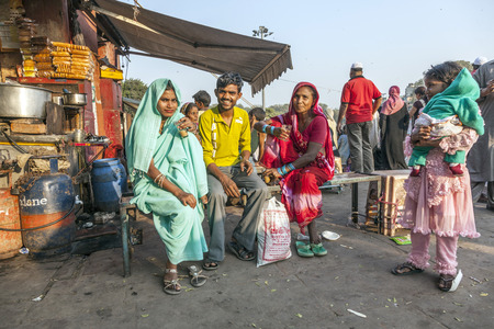 DELHI - NOVEMBER 8, 2011: women relax at a tea shop at the Meena Bazaar Market in Delhi, India. Shah Jahan founded the bazaar in the 17th century inspired by the architecture of the Isfahan Bazaar.