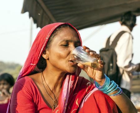 jama mashid: DELHI - NOVEMBER 8, 2011: woman drinking tea at the Meena Bazaar Market in Delhi, India. Shah Jahan founded the bazaar in the 17th century inspired by the Isfahan Bazaar.