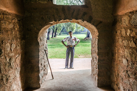 DELHI, INDIA - NOV 11, 2011: guard at the entrance of  Humayuns tomb, built by Hamida Banu Begun in 1565-72 A.D. in Delhi, India. The earliest example of Persian influence in Indian architecture.