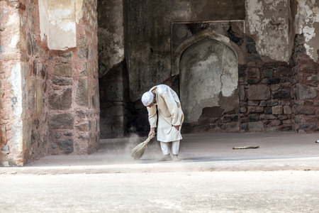 DELHI, INDIA - NOV 11, 2011: workers at Humayun's Tomb cleans the yard in Delhi, India. They also get alms by religious people. The tomb was built by Hamida Banu Begun in 1565-72 A.D.. Stock Photo - 28946428