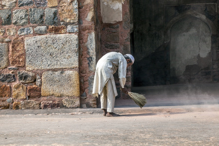 DELHI, INDIA - NOV 11, 2011: workers at Humayun's Tomb cleans the yard in Delhi, India. They also get alms by religious people. The tomb was built by Hamida Banu Begun in 1565-72 A.D.. Stock Photo - 28946431