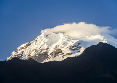 snow capped Antisana Vocano in Ecuador in morning light photo